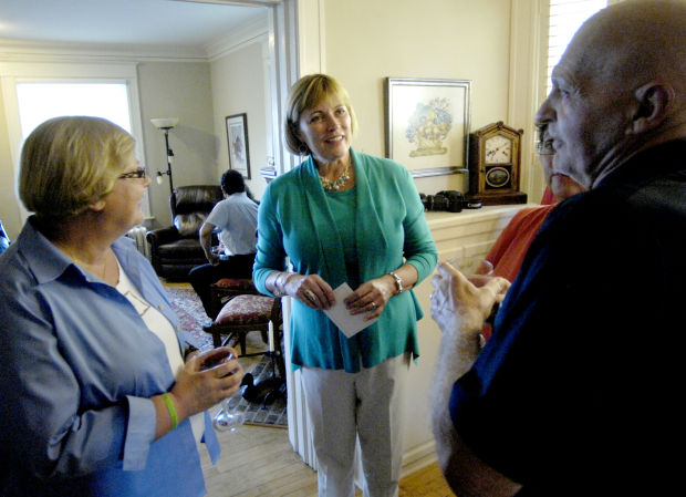 Dr. Lolli Haws talks with Pastor Mary and Revs. Chuck & Sue Ruehle
