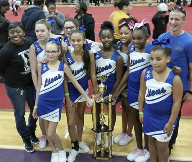 Yeoman Nd Class Ebony Rainey Left Stands With The Larkspur Salem Recreation Cheerleading Team And Assistant Coach Gavin Hawk Right At The Peninsula