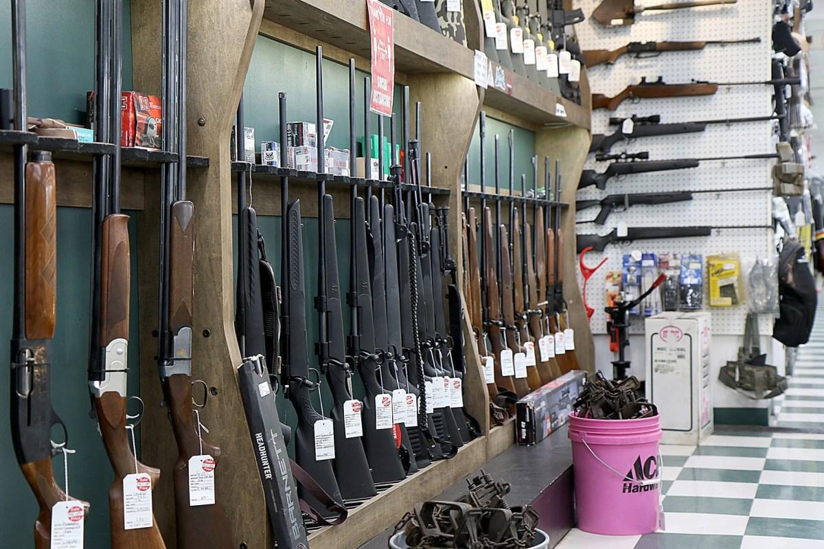 pawn shop installing window gun rack