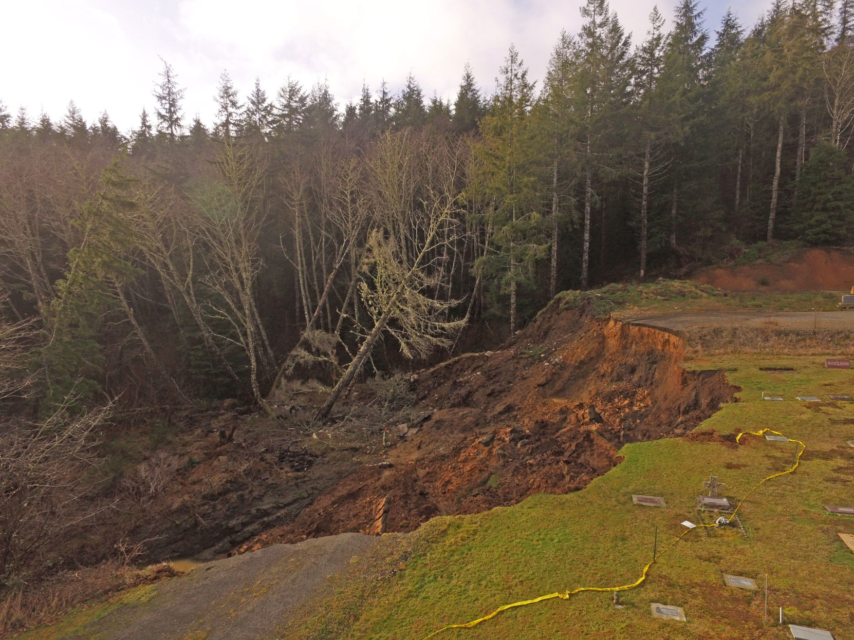Drone photos provide eagle's eye view of Ilwaco Cemetery landslide
