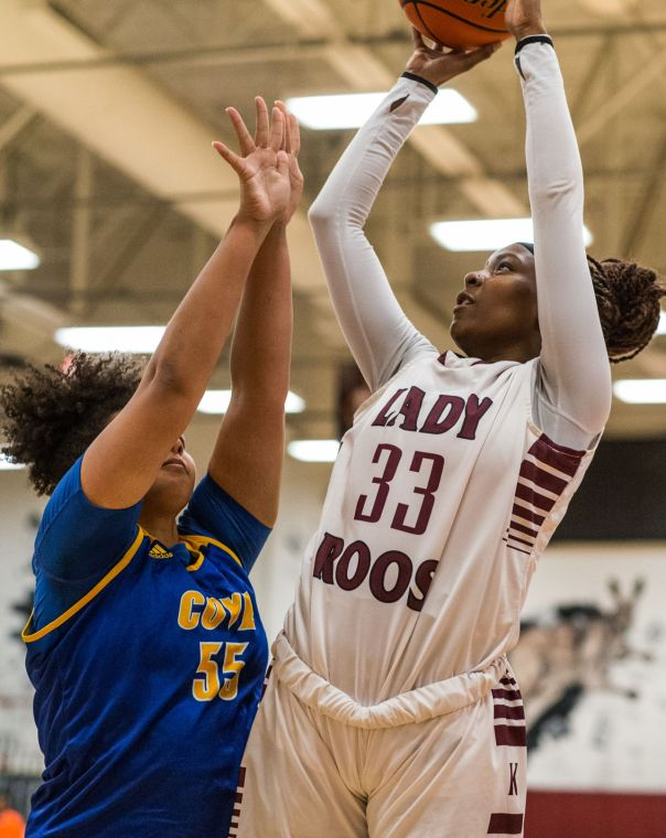 8-6A BASKETBALL: Johnson, Moore help Lady Roos defeat Cove ...