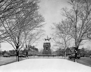 GENERAL LEE WEARS WHITE MANTLE When two inches of snow fell on Richmond last Wednesday, the statue of Robert E. Lee was framed by the snow-laden branches of trees along Monument ave.  The snow was wet and melted quickly.  This photograph actually is a bas