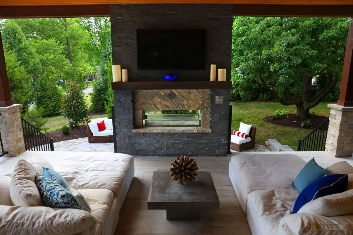 The outdoor living room in this Kirkwood home is an ... on Garden And Outdoor Living  id=70672