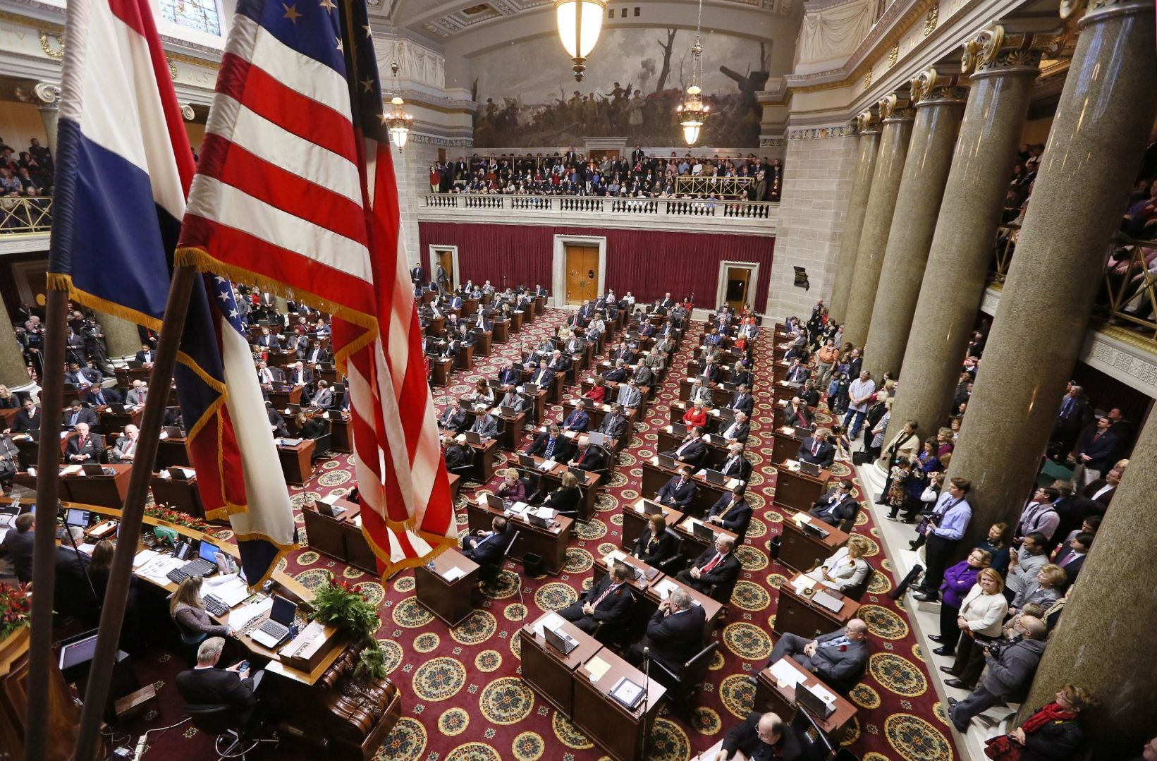 Missouri and U.S. flags adorn the Missouri House of Representatives on opening day 2015. St. Louis Post-Dispatch caption: