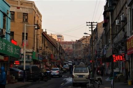 The street Huangdao Lu, full of roadside commerce.