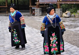 Old Miao ladies welcoming visitors in Xijiang.