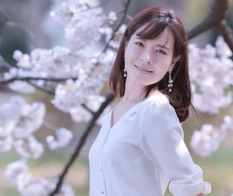 a Japanese woman near Sakura tree