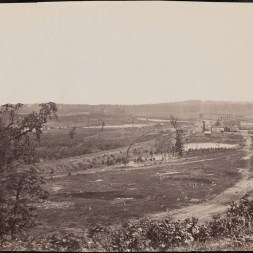 October 2020 I: Battlefield of Resaca, Georgia: Railroad running through river valley with a fortified bridge in background crossing river. River left center. Structures on the right. Small railroad depot left of main structures.