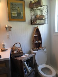 some rustic boxes and crates, with my Montana row-boat shelf add to the decor around the toilet