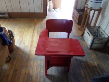 This is a little school desk that was left over from Phyllis' time teaching in this building, now a sumer antiques shop
