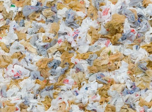 landfill full of plastic bags and wrappers - and they NEVER bio-degrade!
