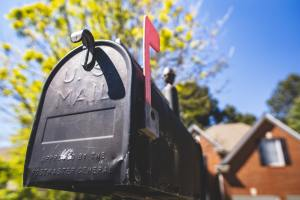 Closeup of a mailbox in front of a house
