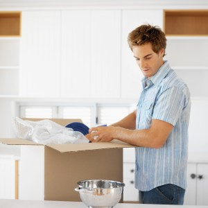 Man unpacking kitchen utensils