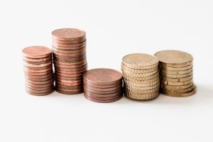 Coins stacked neatly - learn how to boost your relocation budget