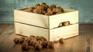 Wooden crate with nuts inside