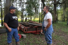 Pct. 5 Constable David Hunter visits with John Colburn, a resident of Sam Houston Lake Estates, on Tuesday.