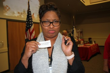 Kristy Fontenette appears to not be amused to get a naughty note in the Dayton Chamber's Naught or Nice game at the Dec. 4 luncheon.