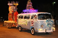"A fully restored Volkswagen van pulled a float carrying ""The Grinch."""