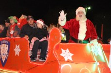 Santa waves to little children from atop a lighted sleigh in the Country Christmas parade on Nov. 27 in Liberty.