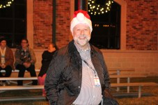 Liberty City Manager Tom Warner watches the Country Christmas parade as it passes by city hall on Nov. 27 in Liberty.
