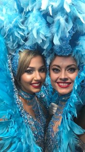 Showgirls in blue feathered costumes