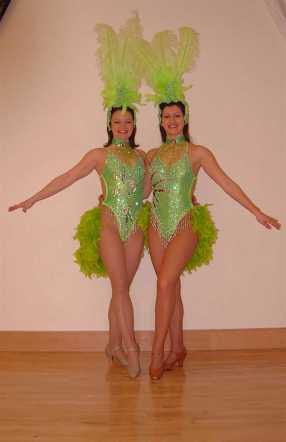 2 Showgirls posing in green