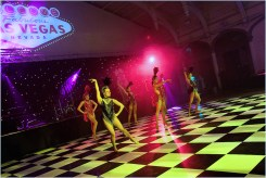 Red and black showgirls performing