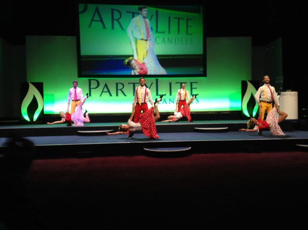 Rock and roll dancers on stage performing a dance lift.