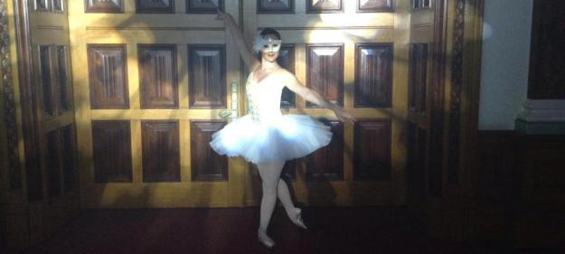 Photo of one of our ballet dancers in white