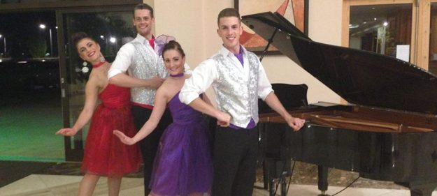 Ballroom dancers performing at an event
