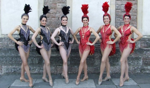 Dancers in showgirl costumes to meet and greet guests at an event