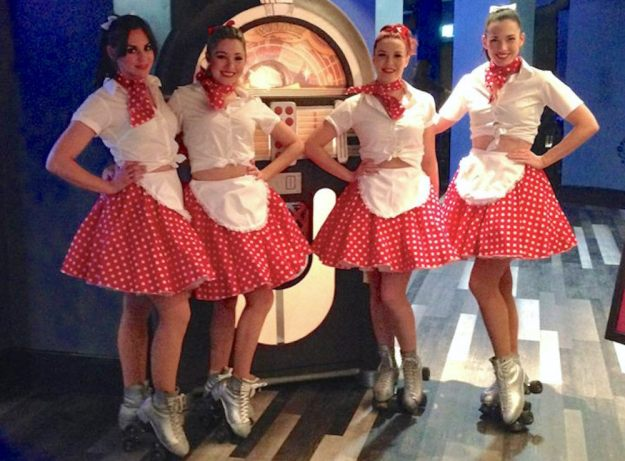 Roller girls dressed as waitresses for meet and greet