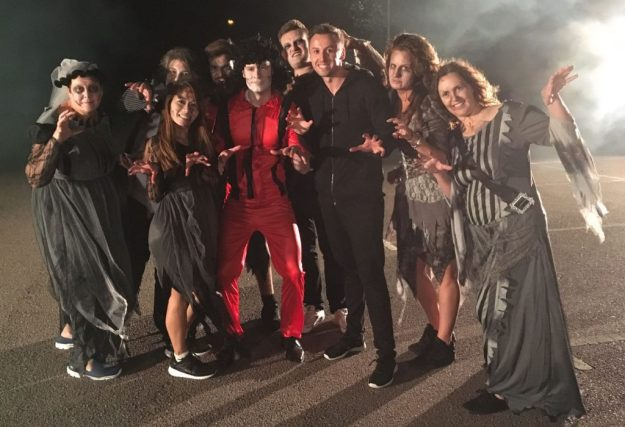 Choreographer surrounded by Participants on a thriller experience.