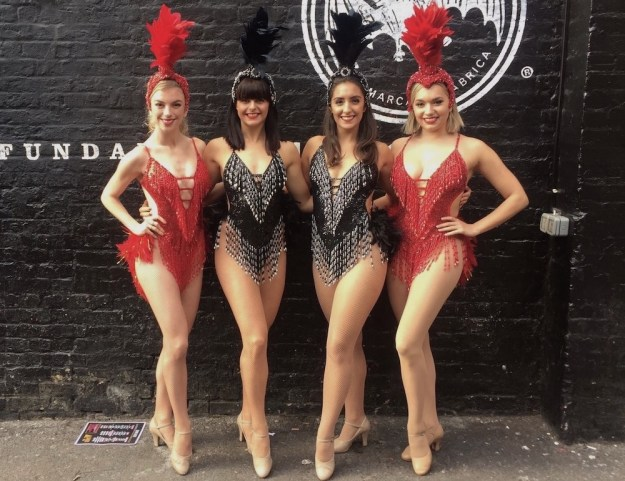 Meet and greet dancers in showgirl outfits