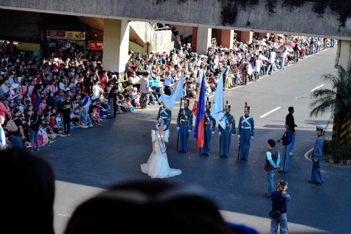 A local schools's cadet officers and their muse poses marches in front of the crowd at Panagbenga 2015.