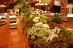 Floral Table Runner; queens ann lace, statice, mosses, and mums ran down the center of the table makes a beautiful choice for a centerpiece
