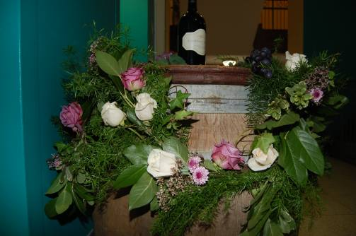 Floral garland created by Bluegrass Chic. Barrels were rented from A Chair Affair.