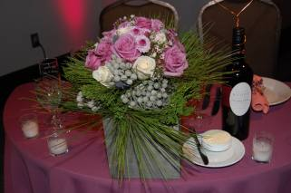 Brides bouqet was placed on the sweetheart table in a wooden box with pine and brunia.