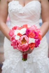 Coral peony, coral rose, hot pink rose, white ranuculus bridal bouquet - Kathy Thomas Photography