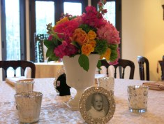 Family heirloom milk glass vases for her reception centerpieces. Old family photos in vintage frames