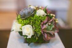 Bridesmaids bouquet of mini green hydrangea, white Vendella roses, succulents and hypericum berry