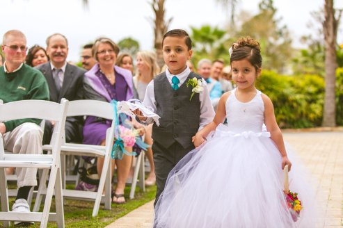Adorable flower girl with bright pomander ball
