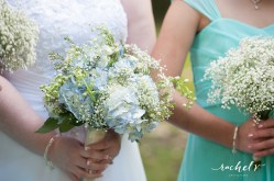 Bridal bouquet of blue hydrangea, white delphenium, wax flower and babies breath