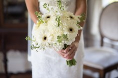 White bridal bouquet with white and black gerbera daisy, white stock and a single blue bird - Bluegrass Chic Floral