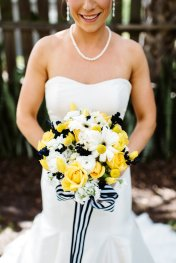 Bridal bouquet of yellow roses, white gerbera, billy balls and navy accents