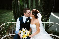 Romantic setting in front of a cactus after the ceremony