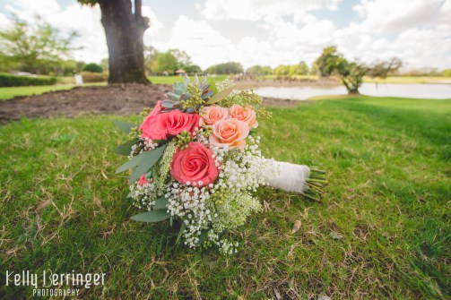 Stunning bridal bouquet with succulents, seeded eucalyptus, peach spray roses, and Amsterdam standard roses