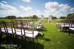 Golf course wedding with free standing doors for ceremony