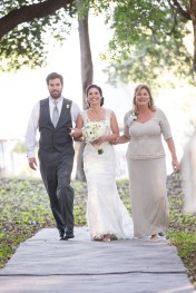 Bride walking down the aisle to meet her groom - Bluegrass Chic Floral