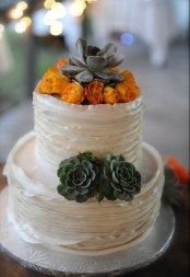 Ruffled, rustic cake with succulents and orange spray roses